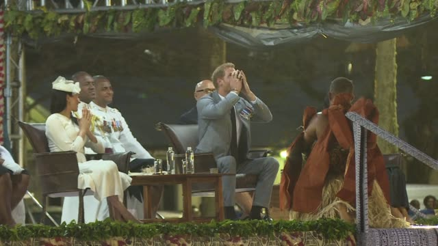 prince harry sips on the narcotic drink kava at a traditional welcoming ceremony in fiji as the island nation gives the british royal and his... - harry meghan tour stock videos and b-roll footage