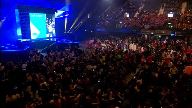prince harry speech at we day event; england: london: wembley: int crowd cheering inside wembley arena and waving placards / banners / wide shots... - wembley arena stock videos & royalty-free footage