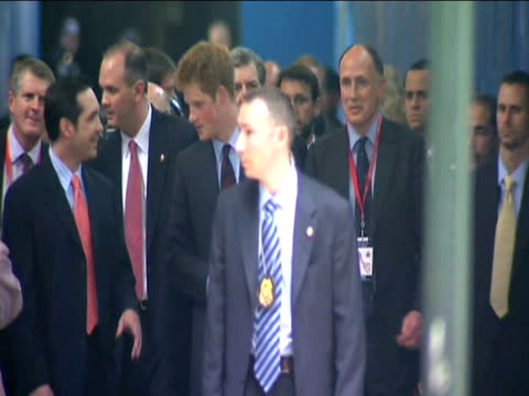 Prince Harry surrounded by security walks towards Ground Zero during tour of US New York 29 May 2009