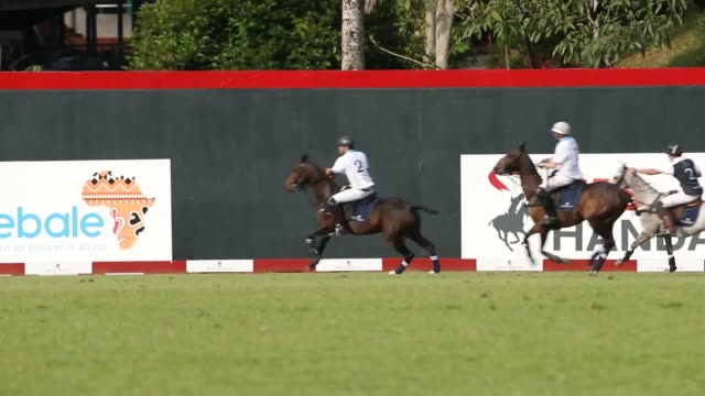 Prince Harry takes part in the Sentebale Royal Salute Polo Cup at the Singapore Polo Club