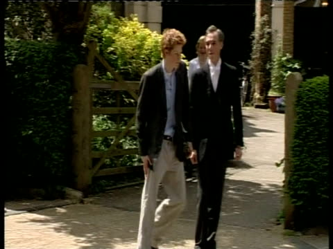 prince harry talks to former housemaster and walks to car gesticulating happily at press having finished education at eton college berkshire 12 jun 03 - eton berkshire stock videos and b-roll footage