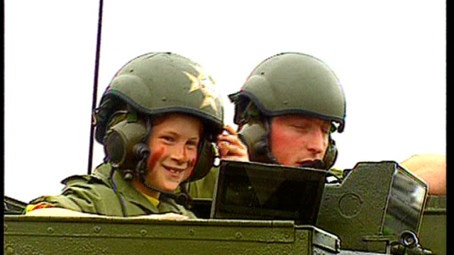 prince harry to leave army after ten years of service lib / prince harry as a child running along with soldier surrey camberley sandhurst royal... - kampfpanzer stock-videos und b-roll-filmmaterial