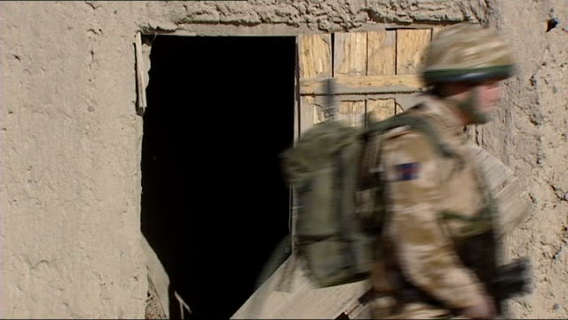 prince harry to return home from afghanistan; afghanistan: helmand province: prince harry patrolling - helmand stock videos & royalty-free footage