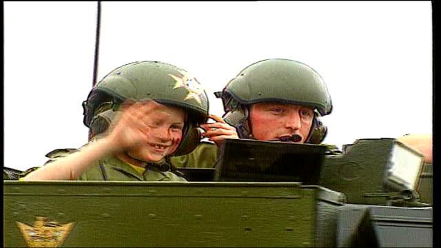 vídeos y material grabado en eventos de stock de prince harry to serve in iraq tx a young prince harry wearing an army helmet on board an apc - 1993