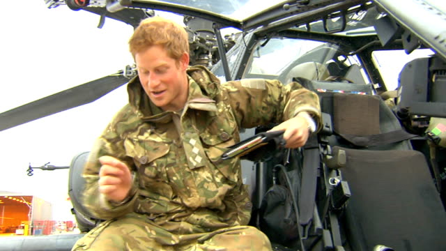 Prince Harry tour of duty in Afghanistan EXT / DAY GVs Harry and copilot warm up the Apache after breakfast GVs running the engines through to check...
