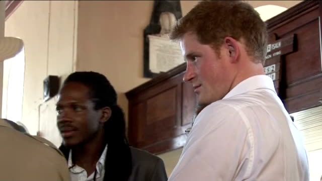 prince harry tour to mark diamond jubilee of queen: harry at montego bay; jamaica: falmouth: ext gvs prince harry shaking hands and talking to... - anglican stock videos & royalty-free footage