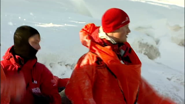 prince harry trains for north pole 'walking wounded' fundraising trek norway spitsbergen ext two team members running and jumping into freezing water... - svalbard and jan mayen stock videos & royalty-free footage