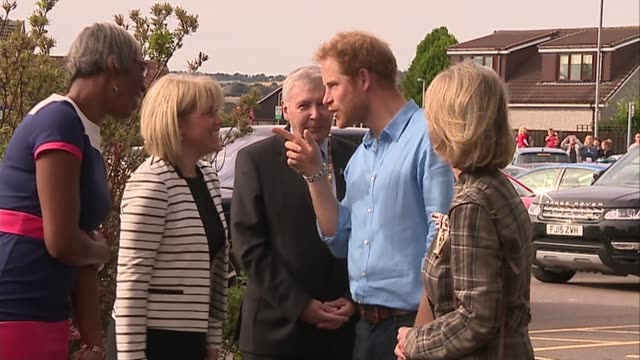 prince harry visit to mackie academy; scotland: aberdeen: mackie academy: ext teenage girls waiting arrival of prince harry / gvs prince harry... - aberdeen scotland stock videos & royalty-free footage