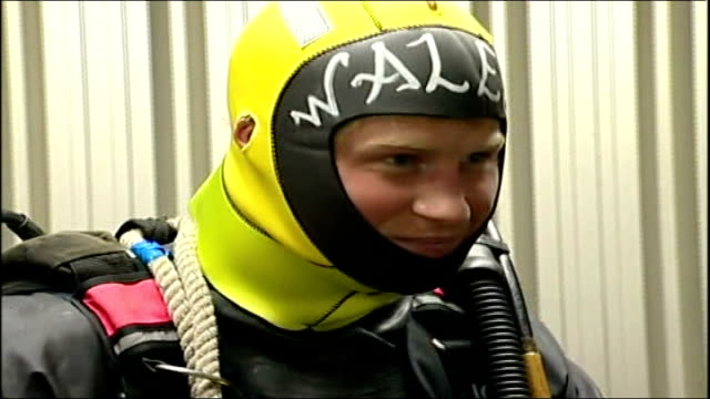 prince harry visit to royal navy bomb disposal unit in portsmouth / harry questioned about birds shot on sandringham estate england portsmouth royal... - diving helmet stock videos and b-roll footage