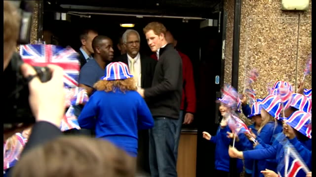 prince harry visit to russell youth club; ext harry comes out of centre / young girl goes up and gives him something / harry waves goodbye / harry... - youth club stock videos & royalty-free footage