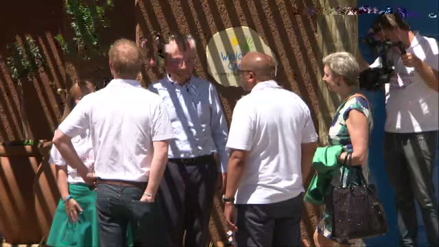 prince harry visits charity in lesotho shows exterior shots prince harry looking at the plaque for the welcome centre walking into the get well... - waisenhaus stock-videos und b-roll-filmmaterial