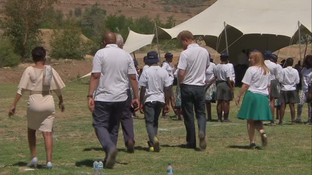 prince harry visits charity in lesotho shows exterior shots prince harry walk with mutsu potsane mamohato children's centre employees on november 26... - waisenhaus stock-videos und b-roll-filmmaterial