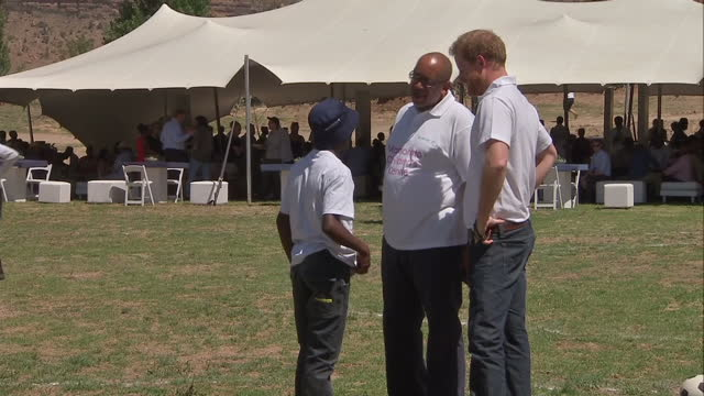 prince harry visits charity in lesotho shows exterior shots prince harry reunited with mutsu potsane on november 26 2015 in maseru lesotho - waisenhaus stock-videos und b-roll-filmmaterial