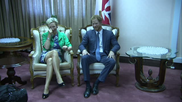 prince harry visits charity in lesotho shows interior shots prince harry walking into room sitting with british high commissioner judith macgregor on... - waisenhaus stock-videos und b-roll-filmmaterial