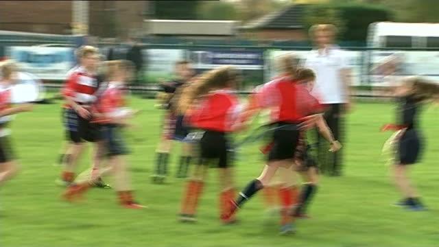 vídeos y material grabado en eventos de stock de prince harry visits eccles rfc children playing rugby / harry watching as children play rugby and shouting encouragement and instructions / harry... - rugby