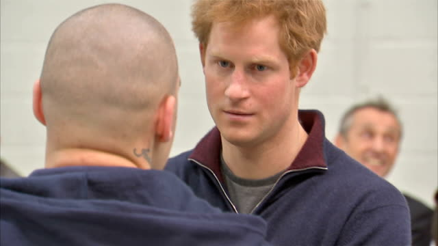 prince harry visits goodwood motor circuit harry in airplane hangar chatting to staff prince harry into spitfire plane / harry posing for photocall... - goodwood stock videos and b-roll footage