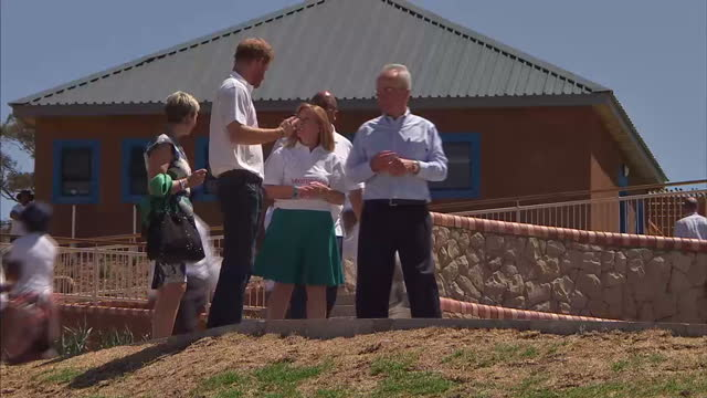 prince harry visits mamohato children's centre with sentebale charity shows exterior shots prince harry walking around the mamohato children's centre... - waisenhaus stock-videos und b-roll-filmmaterial