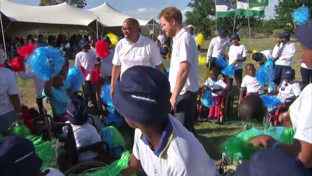 prince harry visits mamohato children's centre with sentebale charity shows exterior shots prince harry prince seeiso surrounded by children singing... - waisenhaus stock-videos und b-roll-filmmaterial