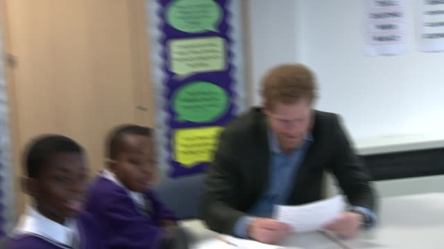 prince harry visits nottingham prince harry visits nottingham prince harry into classroom and sitting with children having a music class / prince... - headphones stock videos & royalty-free footage