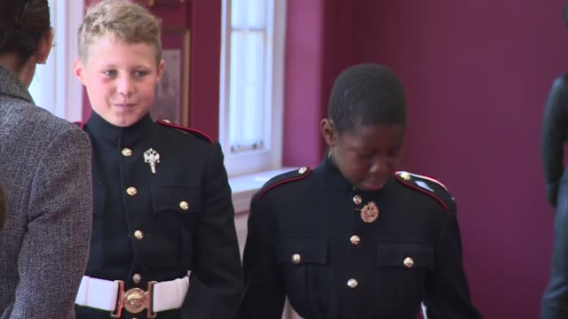 prince harry visits royal military school in dover prince harry along as leaving square / cadets excitably chatting and hugging / 'the duke of york's... - principe harry video stock e b–roll