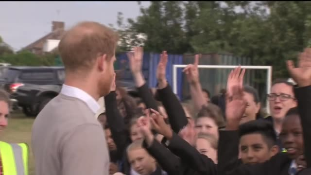 prince harry visits school in luton; england: bedfordshire: luton: ext schoolchildren playing rugby / prince harry, duke of sussex along school... - high five stock videos & royalty-free footage