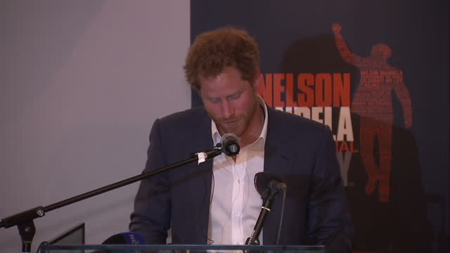 prince harry visits the nelson mandela centre shows interior shot prince harry walks to podium begins making speech talking about how he cherishes... - waisenhaus stock-videos und b-roll-filmmaterial