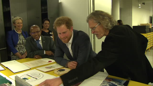 prince harry visits the nelson mandela centre shows interior shots prince harry looking over items from the mandela archive on december 03 2015 in... - waisenhaus stock-videos und b-roll-filmmaterial
