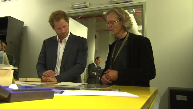 prince harry visits the nelson mandela centre shows interior shots prince harry speaking to curator of the archive while looking over letters other... - waisenhaus stock-videos und b-roll-filmmaterial