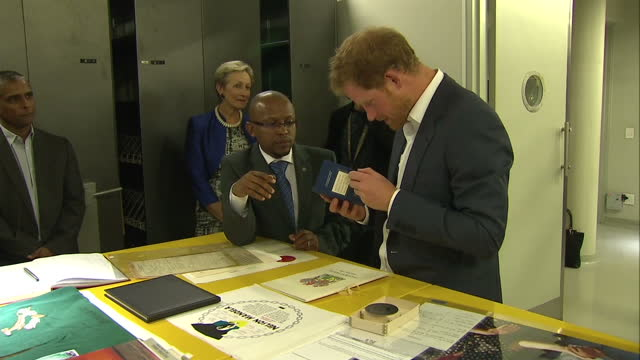 prince harry visits the nelson mandela centre shows interior shots prince harry looking through nelson mandela's passport on december 03 2015 in... - waisenhaus stock-videos und b-roll-filmmaterial