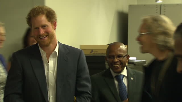 prince harry visits the nelson mandela centre shows interior shots prince harry walking into archive greeted by curator on december 03 2015 in... - waisenhaus stock-videos und b-roll-filmmaterial