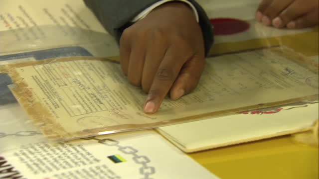 prince harry visits the nelson mandela centre shows interior shots prince harry looking over item in archive on december 03 2015 in johannesburg... - waisenhaus stock-videos und b-roll-filmmaterial