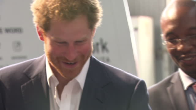 prince harry visits youth empowerment exposition at the bus factory shows interior shots prince harry being shown devices from maker library network... - waisenhaus stock-videos und b-roll-filmmaterial