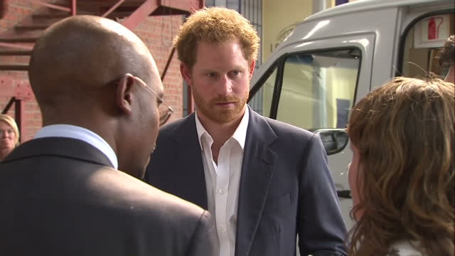 prince harry visits youth empowerment exposition at the bus factory shows interior shots prince harry being shown devices at the maker library... - waisenhaus stock-videos und b-roll-filmmaterial