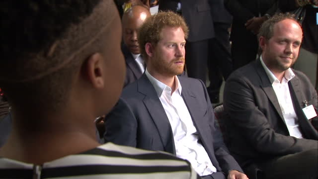 prince harry visits youth empowerment exposition at the bus factory shows interior shots prince harry sat listening to presentation at youth... - waisenhaus stock-videos und b-roll-filmmaterial