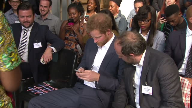 Prince Harry visits Youth Empowerment Exposition at the Bus Factory Shows interior shots Prince Harry sat at Youth Empowerment Exposition on his...