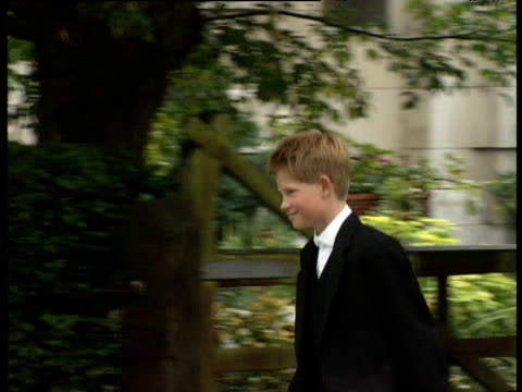 prince harry walks in direction of school chapel with fellow pupils wearing eton school uniform on his first day berkshire 03 sep 98 - eton berkshire stock videos and b-roll footage