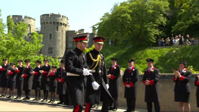 prince harry walks with his brother and best man prince william, the duke of cambridge, towards windsor castle's st george's chapel on the day of his... - uniform stock videos & royalty-free footage