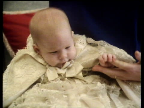 prince harry's christening england windsor castle cms princess diana holding harry in christening robes sitting with william on sofa william ms... - プリンス点の映像素材/bロール