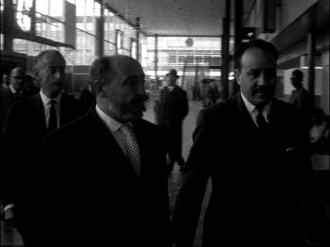 Prince Hassan returns to Yemen after assassination of king ENGLAND London Airport INT Various shots of Prince Hassan along at airport and talking to...