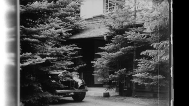 prince konoe smokes as he socializes with guests at the royal villa in karuizawa - 1940 stock videos & royalty-free footage