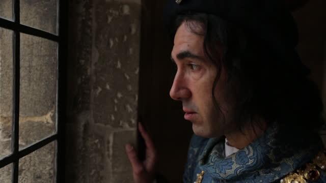 prince looking through window - medieval era reenactment - staring stock videos & royalty-free footage