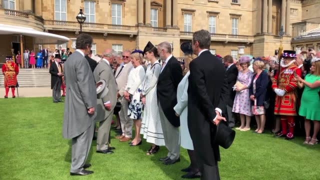prince of wales and duchess of cornwall host the first garden party of the summer at buckingham palace on one of the warmest days of the year - garden party stock videos & royalty-free footage