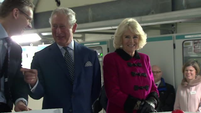 prince of wales and duchess of cornwall pressing red button to open national grid's london power tunnels project filmed from 2 angles - コーンウォール公爵夫人 カミラ点の映像素材/bロール