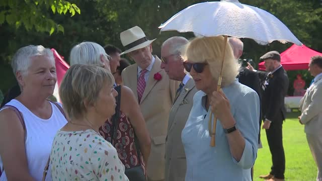 prince of wales and duchess of cornwall visit bideford; england: devon: bideford: ext band with bagpipes playing / camilla, duchess of cornwall from... - sunglasses stock videos & royalty-free footage