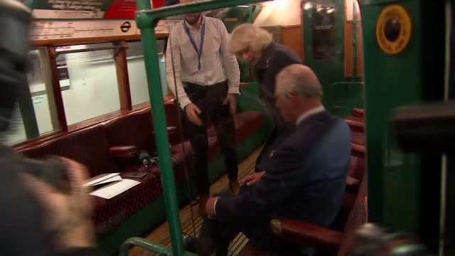 vídeos de stock, filmes e b-roll de prince of wales and duchess of cornwall visit london transport museum; england: london: covent garden: london transport museum: int **some flash... - air raid