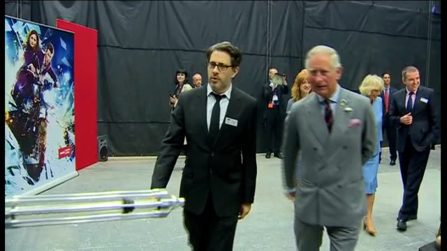 prince of wales and duchess of cornwall visit the set of dr who in cardiff; wales: cardiff: int camilla, duchess of cornwall holding dr who's sonic... - doctor who stock videos & royalty-free footage