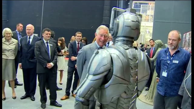 prince of wales and duchess of cornwall visit the set of dr who in cardiff prince charles and camilla meeting ood and cyberman characters / prince... - laughing stock videos & royalty-free footage