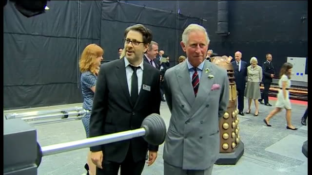 prince of wales and duchess of cornwall visit the set of dr who in cardiff; prince charles and matt smith chatting on set of dr who show / prince... - ドクター フー点の映像素材/bロール