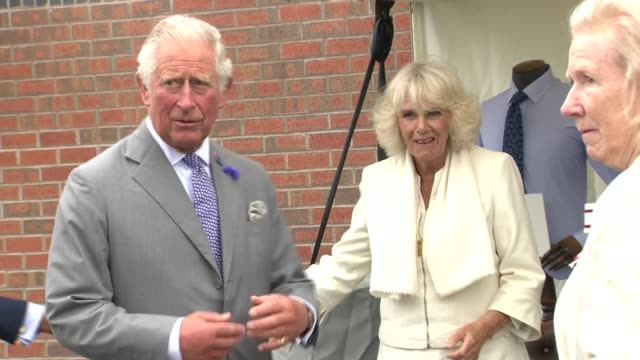 prince of wales and duchess of cornwall visit turnbull and asser shirt factory; england: gloucestershire: gloucester: quedgeley: turnbull & asser... - prinz von wales stock-videos und b-roll-filmmaterial