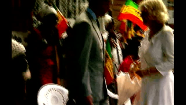 stockvideo's en b-roll-footage met prince of wales and duchess of cornwall visiting bob marley centre in jamaica; **note: poor picture quality throughout** jamaica: kingston: rose... - bob marley musician
